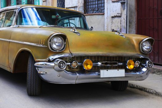 Vintage cars moving on the streets of colorful Havana. A great variety of old cars exist In Cuba. On the streets cars from the first half of the 20th century can be found in magnificent conditions, which takes back in history and make the old atmosphere of the cities.