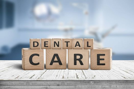 Dental care sign on a table at a dentist with a blurry blue room in the background