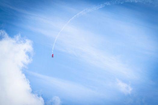 Veteran airplane makes a loop in the sky