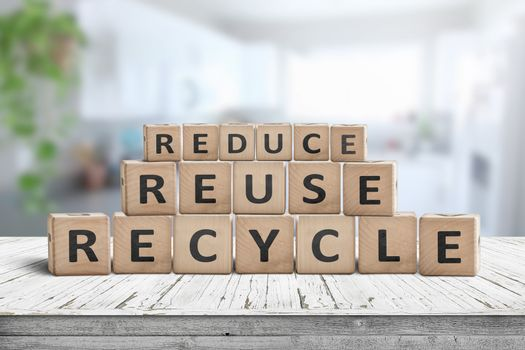 Reduce, reuse and recycle sing on a wooden desk