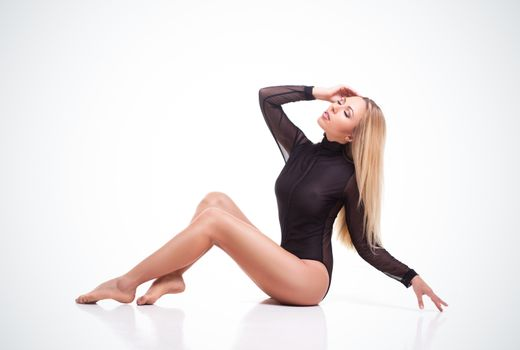 blond woman with long hair in black underwear