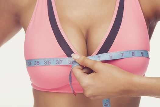 woman measuring her breast