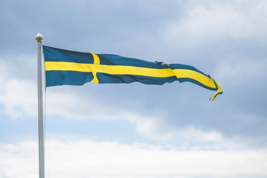 Swedish pennant flag on a flagpole in the wind