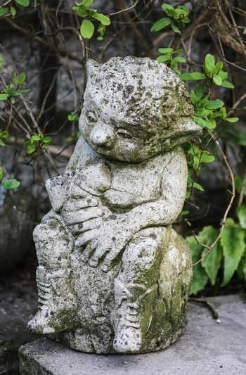 statue of a little imp from a yellow stone.