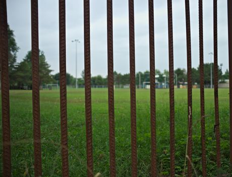 Entrance gate bars to a football field