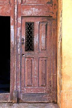 Tricycle and old door from Havana