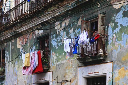 Hanging laundry to dry on balcony in Havana