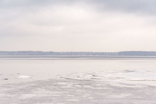 Frozen lake in the wintertime with ice