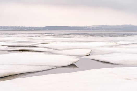 Ice floe on a frozen lake in the wintertime