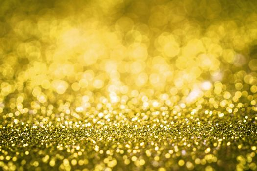 Yellow glitter texture christmas or valentine's day background. Macro shot