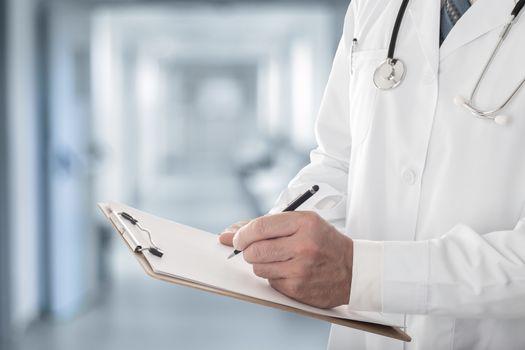Doctor filling up medical form