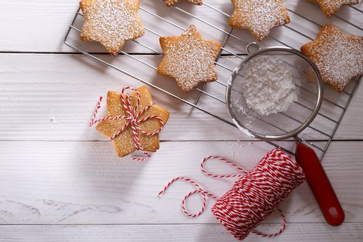 Christmas gingerbread shortbread cookies on white wooden table flat lay copy space