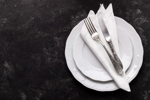 White plates and vintage cutlery