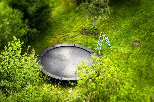 Large trampoline in a garden with a ladder