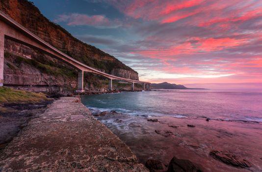 Sea Cliff Bridge and sunrise ocean