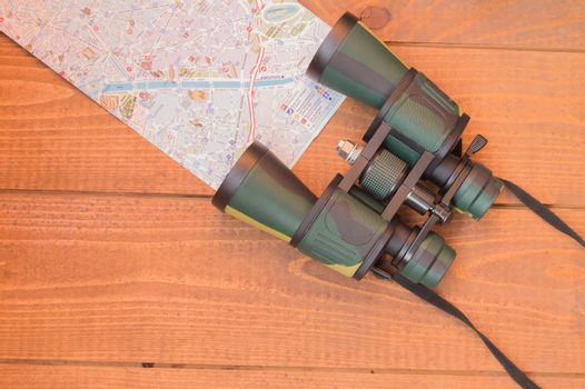 Travel planning, vacation tourism travel binoculars and map.