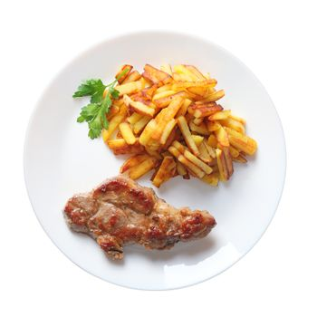 steak with fried potatoes isolated top view