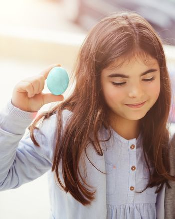 Cute girl with painted Easter egg