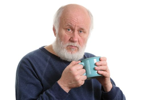 Elderly grey haired man with blue cup of tea or coffe isolated on white
