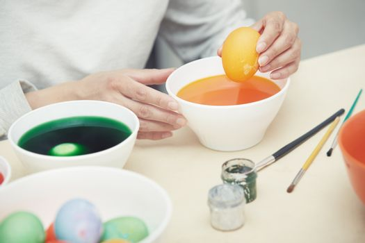 Woman preparing and dying Easter eggs