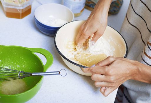 Hands of the woman preparing pie pastry
