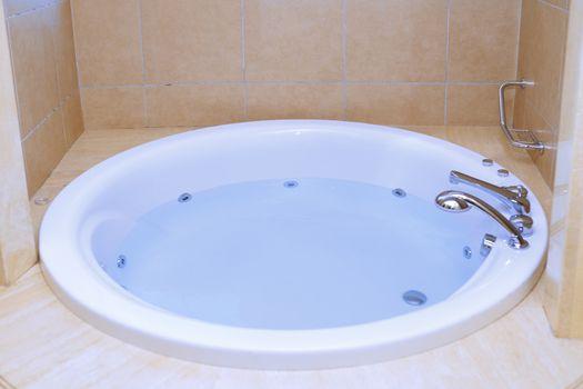 Modern bathtub full of water