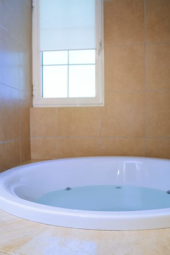 Modern bathroom with bathtube full of water