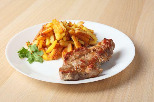 steak with fried potatoes side wiev