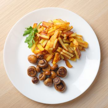 fried potatoes with mushrooms top view