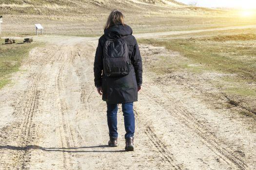 Caucasian woman in black coat