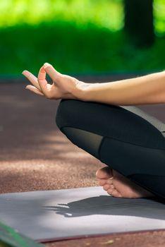 female hand close up lotus pose yoga asana