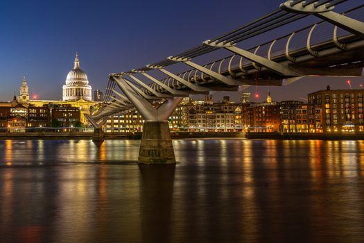 St paul cathedral with millennium bridge sunset twilight in London UK.