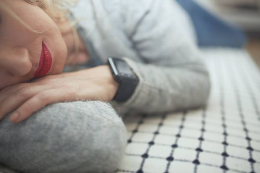 Woman sleeping with smart watch