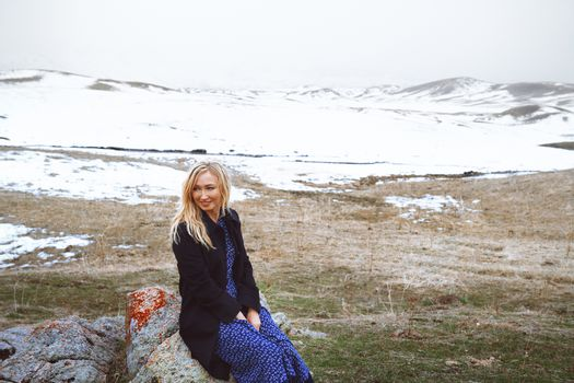 Smiling woman in the winter landscape