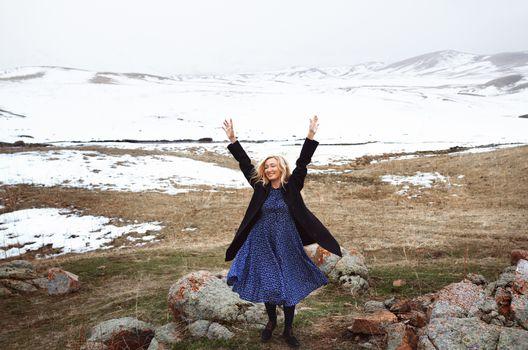 Happy woman in the winter landscape