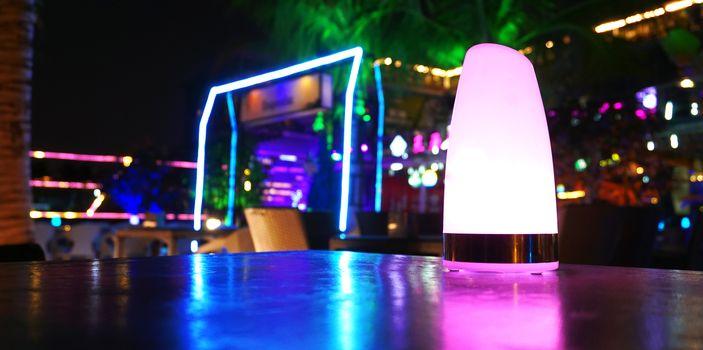 Tropical beach club bar at night