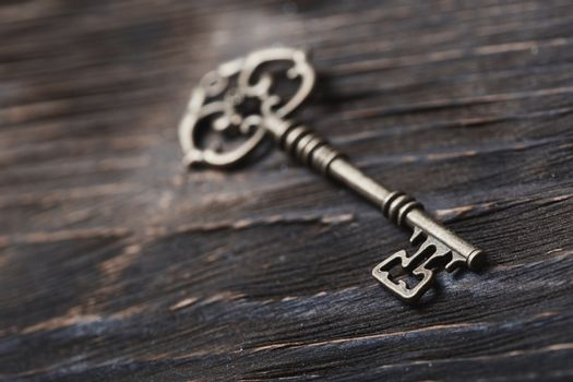Vintage skeleton key on a table. Close-up