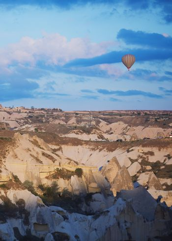Hot air balloon flying over the rocks of Cappadocia, Turkey