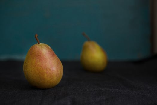 Two fresh pears on a table. Close-up view
