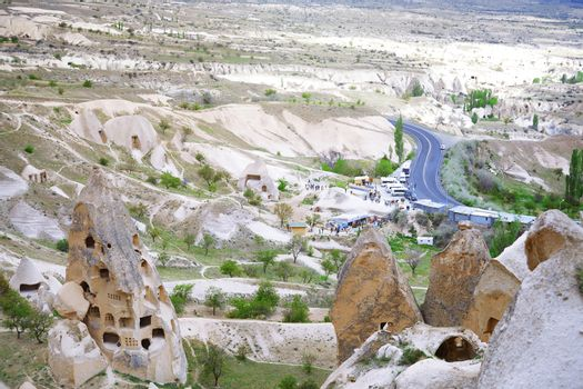 Travel bus station with crowd of people in rocky valley of Cappadocia, Turkey