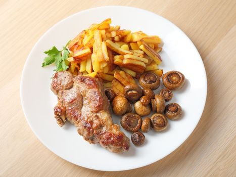 steak with fried potatoes and mushrooms
