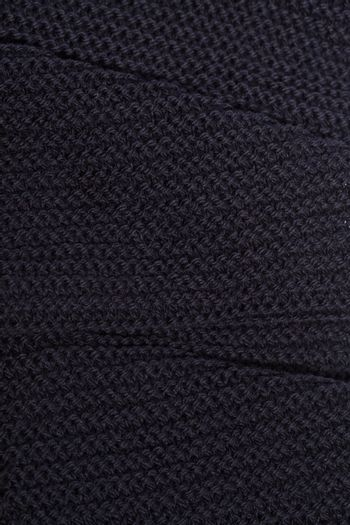 Knitted black scarf texture