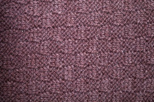 Knitted brown scarf texture background.