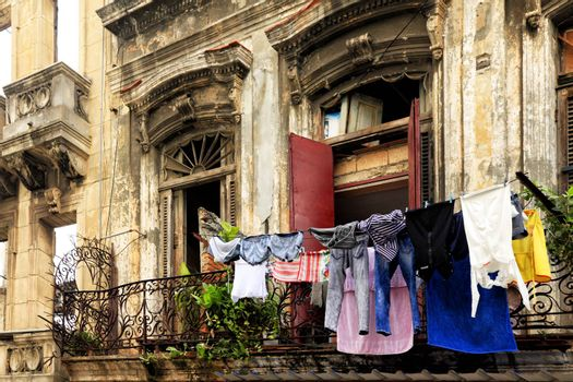 Hanging laundry to dry on balcony in Havana, Cuba
