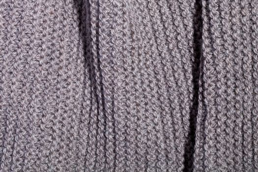 Knitted brown scarf texture