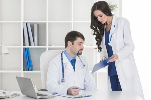 Young assistant and doctor