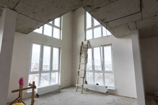 The interior of the first floor in a two-story apartment in a new building