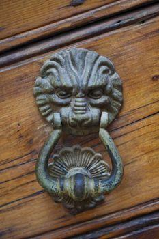 Lion shaped door knocker.