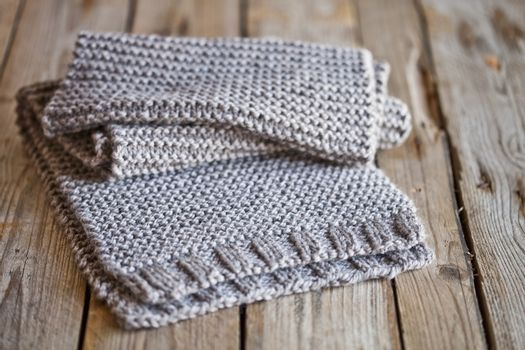 Beige knitted wooden scarf