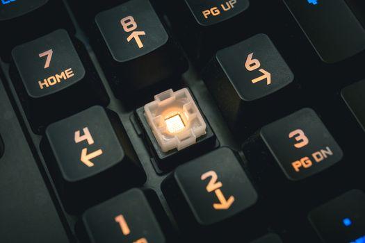 Backlit mechanical keyboard numerical buttons detail shot.